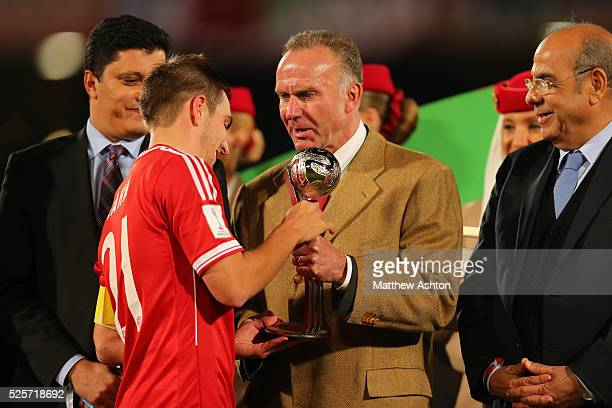 Winner of the FIFA Club World Cup 2013 Silver Ball Award Philipp Lahm of Bayern Munich receiving his award from chief executive officer of FC Bayern...