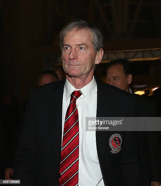 Winner of the Foster Hewitt Memorial Award Pat Foley walks the red carpet prior to the induction ceremony at the Hockey Hall of Fame on November 17...