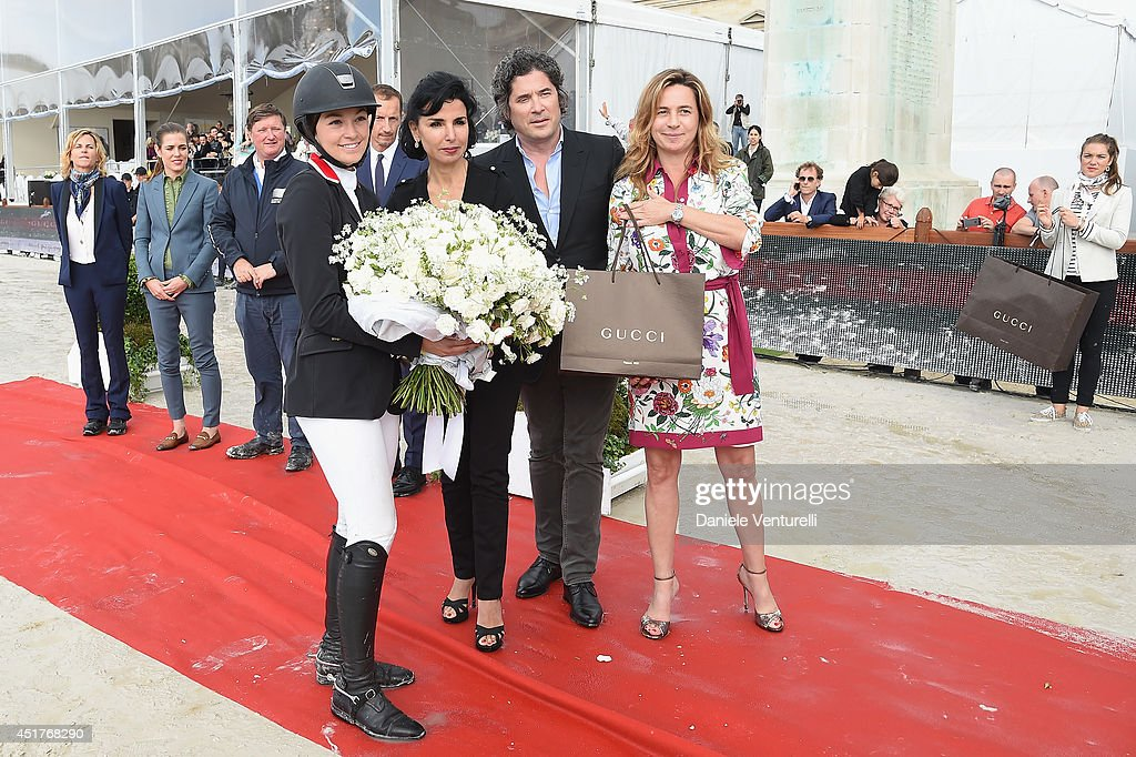 Winner of the 'Gucci Gold Cup Paris Eiffel Jumping Table A against the clock with jump-off ' (C) Reed Kessler (3rd rank) poses with Rachida Dati, Christophe Bonnat and Coco Couperie Eiffel during the Paris Eiffel Jumping presented by Gucci at Champ-de-Mars on July 6, 2014 in Paris, France.