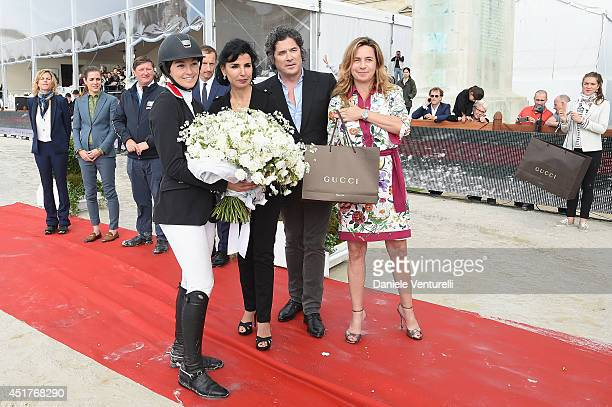 Winner of the 'Gucci Gold Cup Paris Eiffel Jumping Table A against the clock with jumpoff ' Reed Kessler poses with Rachida Dati Christophe Bonnat...