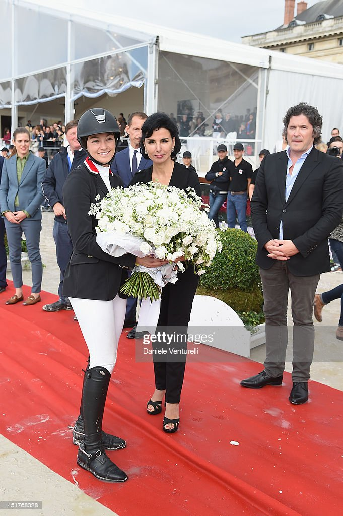 Winner of the 'Gucci Gold Cup Paris Eiffel Jumping Table A against the clock with jump-off ' (C) Reed Kessler (3rd rank) poses with Rachida Dati and Christophe Bonnat during the Paris Eiffel Jumping presented by Gucci at Champ-de-Mars on July 6, 2014 in Paris, France.