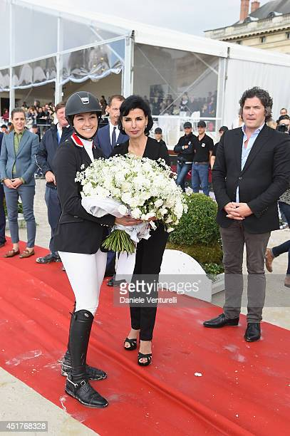 Winner of the 'Gucci Gold Cup Paris Eiffel Jumping Table A against the clock with jumpoff ' Reed Kessler poses with Rachida Dati and Christophe...