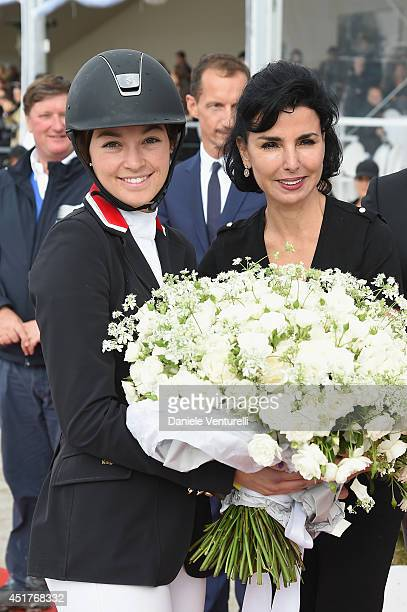 Winner of the 'Gucci Gold Cup Paris Eiffel Jumping Table A against the clock with jumpoff ' Reed Kessler poses with Rachida Dati during the Paris...