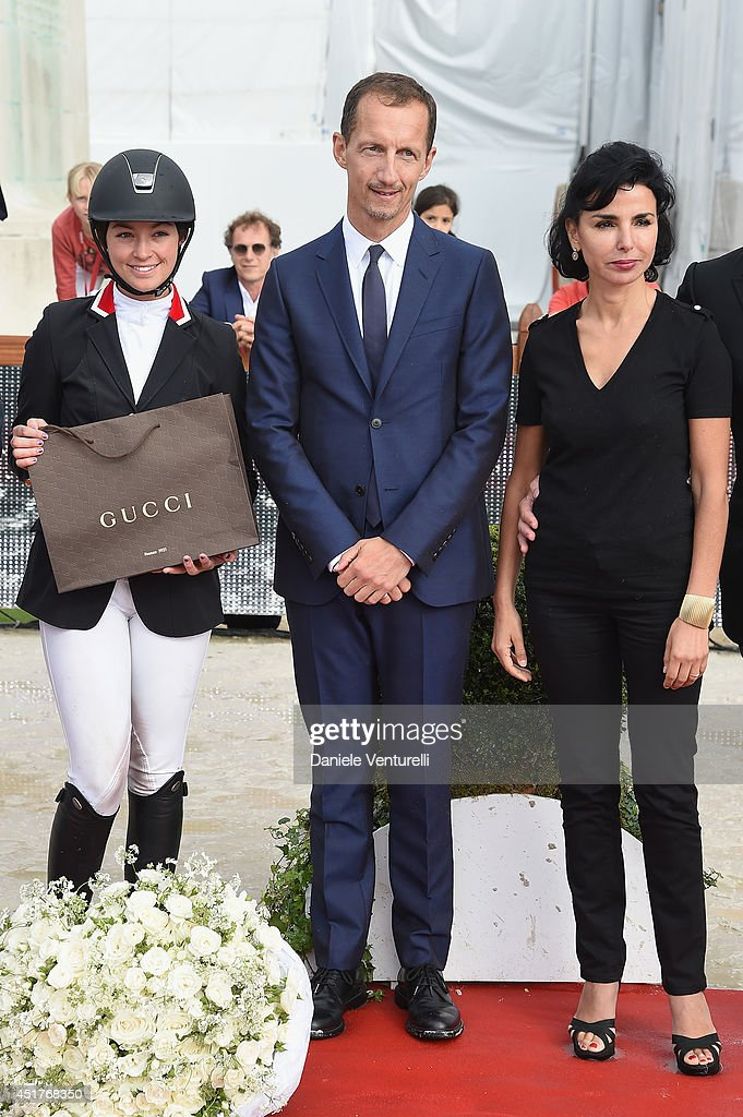 Winner of the 'Gucci Gold Cup Paris Eiffel Jumping Table A against the clock with jump-off ' (C) Reed Kessler (3rd rank) poses with Robert Triefus and <a gi-track='captionPersonalityLinkClicked' href=/galleries/search?phrase=Rachida+Dati&family=editorial&specificpeople=4111042 ng-click='$event.stopPropagation()'>Rachida Dati</a> during the Paris Eiffel Jumping presented by Gucci at Champ-de-Mars on July 6, 2014 in Paris, France.