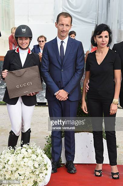 Winner of the 'Gucci Gold Cup Paris Eiffel Jumping Table A against the clock with jumpoff ' Reed Kessler poses with Robert Triefus and Rachida Dati...