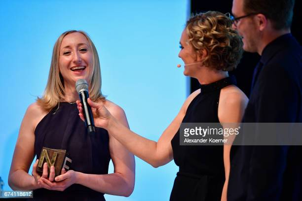 Winner of the 'Investigative Journalism' Award Vanessa Wormer host Caren Miosga and award winner Frederik Obermaier speak on stage at the Nannen...