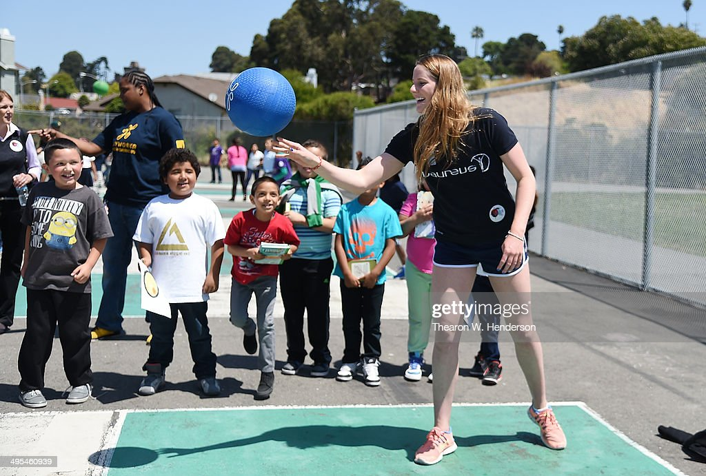 Winner of the Laureus World Sports Award for a female athlete and four-time Olympic gold medalist Missy Franklin plays fourquare with studends at Bayview Elementary School during a visit on June 3, 2014 in San Pablo, California.