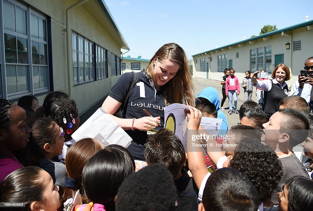 Winner of the Laureus World Sports Award for a female athlete and four-time Olympic gold medalist Missy Franklin signs autographs for the students during a visit to Bayview Elementary School on June 3, 2014 in San Pablo, California.