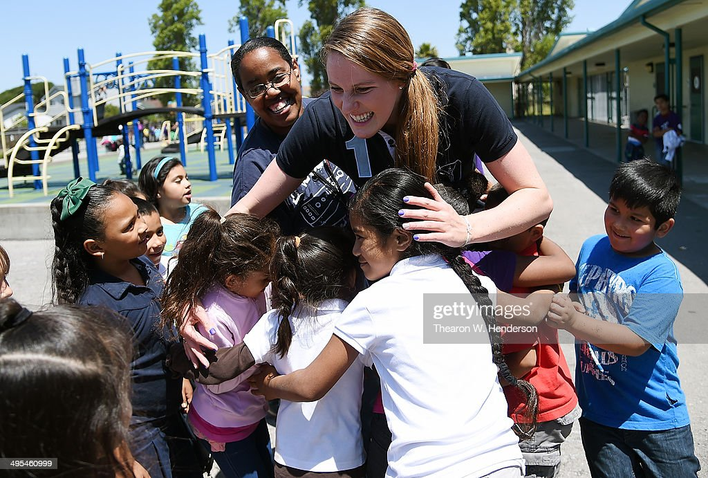 Winner of the Laureus World Sports Award for a female athlete and four-time Olympic gold medalist Missy Franklin hugs several studends at Bayview Elementary School during a visit on June 3, 2014 in San Pablo, California.