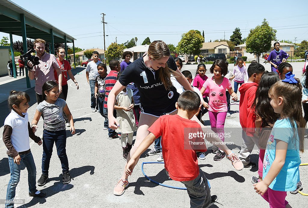 Winner of the Laureus World Sports Award for a female athlete and four-time Olympic gold medalist Missy Franklin plays hula hoop tag with studends at Bayview Elementary School during a visit on June 3, 2014 in San Pablo, California.
