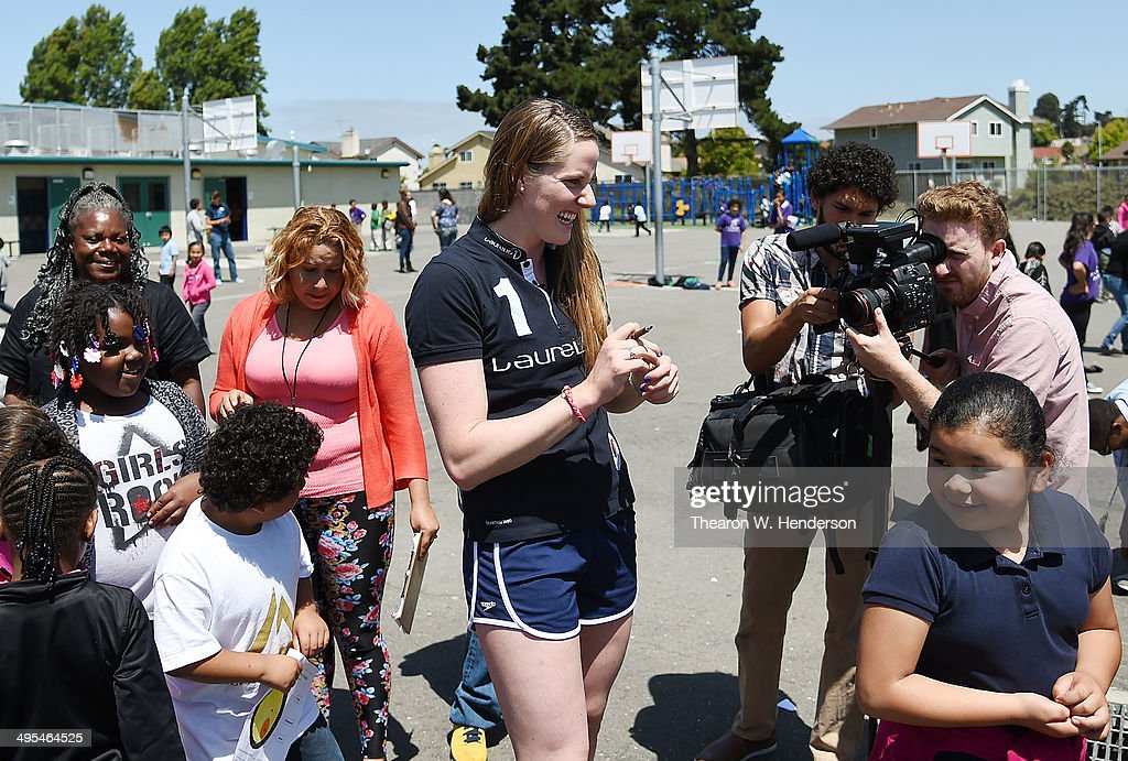 Winner of the Laureus World Sports Award for a female athlete and four-time Olympic gold medalist Missy Franklin standing in line waiting her turn to play foursquare with students from Bayview Elementary School during her visit to the school on June 3, 2014 in San Pablo, California.