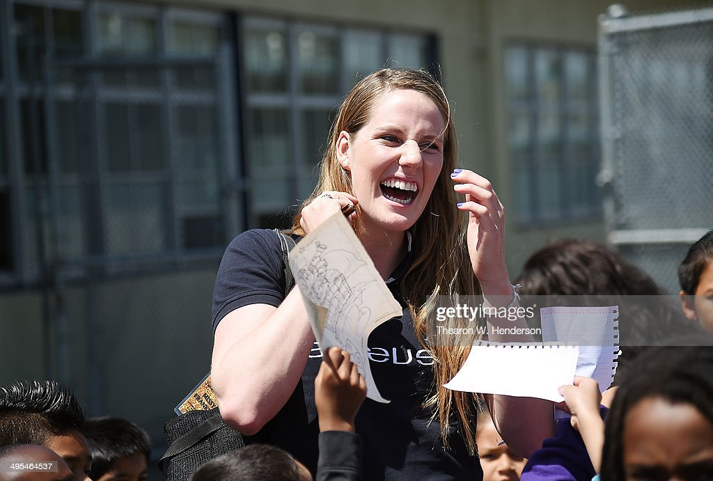 Winner of the Laureus World Sports Award for a female athlete and four-time Olympic gold medalist Missy Franklin is surrounded by students seeking her autograph during her visit to Bayview Elementary School on June 3, 2014 in San Pablo, California.