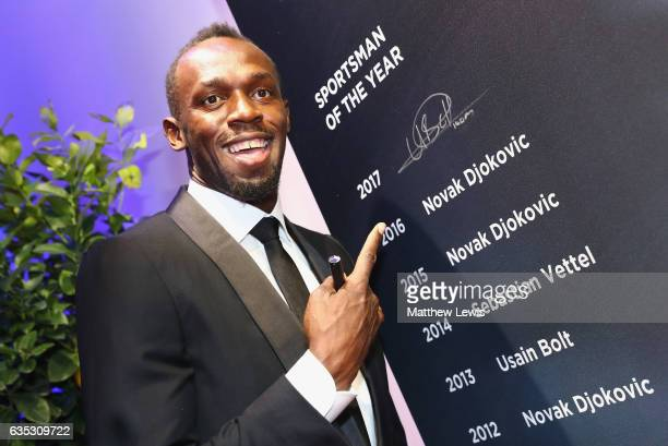 Winner of the Laureus World Sportsman of the Year Award Athlete Usain Bolt of Jamaica writes his name on a winners board after the Laureus World...