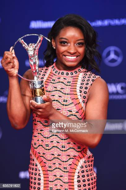 Winner of the Laureus World Sportswoman of the Year Award Gymnast Simone Biles of the US poses with her trophy the Winners Press Conference and...