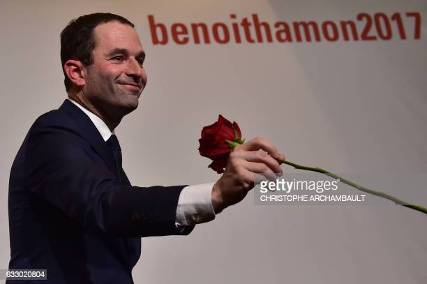 Winner of the leftwing primaries ahead of France's 2017 presidential elections Benoit Hamon holds a rose prior to deliver a speech following the...