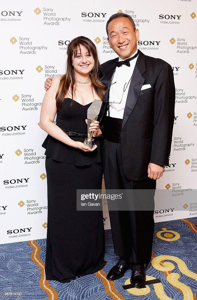 Winner of the L'Iris d'Or award Sara Naomi Lewkowicz and award presenter Masaru Tamagawa, President Sony Europe during the 2014 Sony World Photography awards (SWPA) at the London Hilton on April 30, 2014 in London, England.