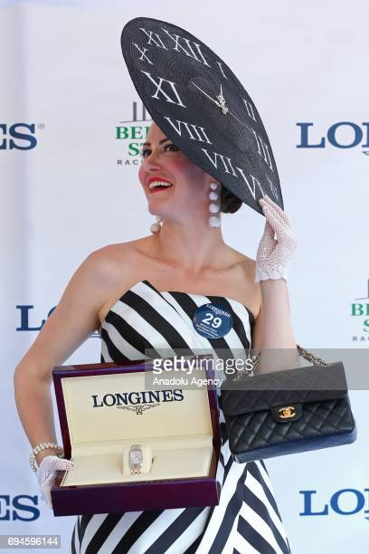 Winner of the Longines Most Elegant Woman fashion contest Leckie Roberts poses for a photo during the 149th Running of the Belmont Stakes at Belmont...