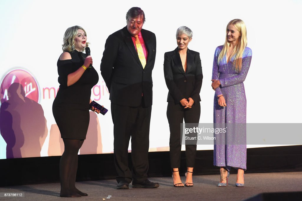 Winner of the Making a Difference award, Bryony Gordon, president of Mind Stephen Fry and Mind ambassadors Frankie Bridge and Fearne Cotton on stage at the Virgin Money Giving Mind Media Awards at Odeon Leicester Square on November 13, 2017 in London, England.