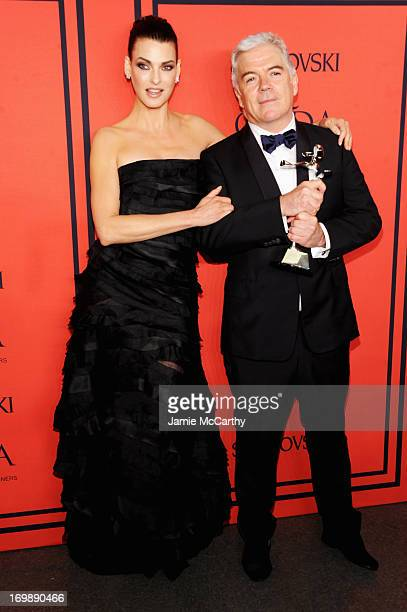Winner of the Media Award in Honor of Eugenia Sheppard Tim Blanks poses with Linda Evangelista at the 2013 CFDA Fashion Awards on June 3 2013 in New...