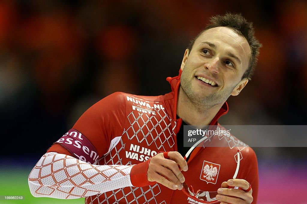 Winner of the men's 500 meter Konrad Niedzwiedzki from Poland celebrates after his race during the European Speed Skating Championships in Heerenveen, Netherlands, on January 11, 2013. The championships started today and be held until January 13. AFP PHOTO / ANP / BAS CZERWINSKI - netherlands out -
