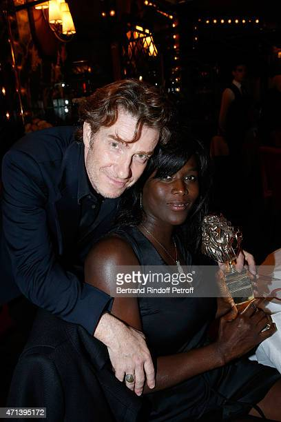 Winner of the 'Moliere du Comedien dans un second role' with 'Les Cartes du pouvoir' Thierry Fremont and his wife Gina attend the Dinner after the...