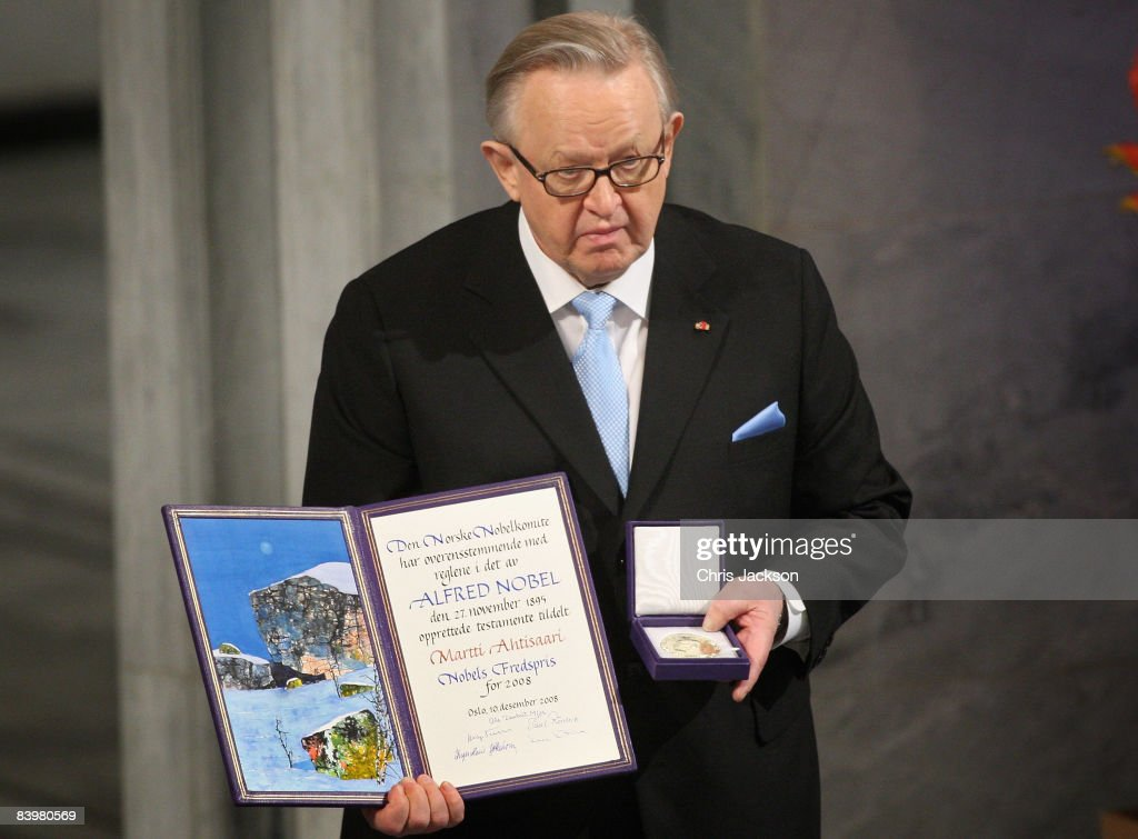 Winner of the Nobel Peace Prize 2008, Martti Ahtisaari holds up the prize at the Nobel Peace Prize Ceremony 2008 in Oslo City Hall on December 10, 2008 in Oslo, Norway. The Norwegian Nobel Committee has decided to award the Nobel Peace Prize for 2008 to Martti Ahtisaari for his important efforts, on several continents and over more than three decades, to resolve international conflicts.