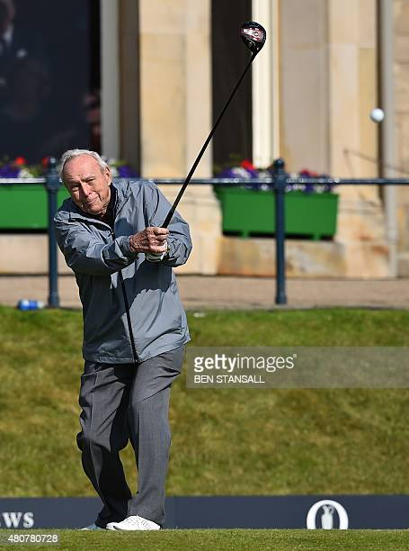 Winner of The Open in 1961 and 1962 US golfer Arnold Palmer plays from the 1st tee during the Champion Golfers' Challenge on The Old Course at St...