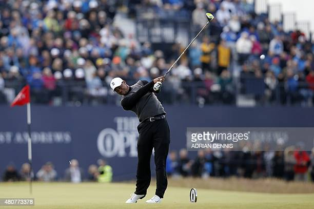 Winner of The Open in 2000 2005 and 2006 US golfer Tiger Woods plays from the 18th tee during the Champion Golfers' Challenge on The Old Course at St...