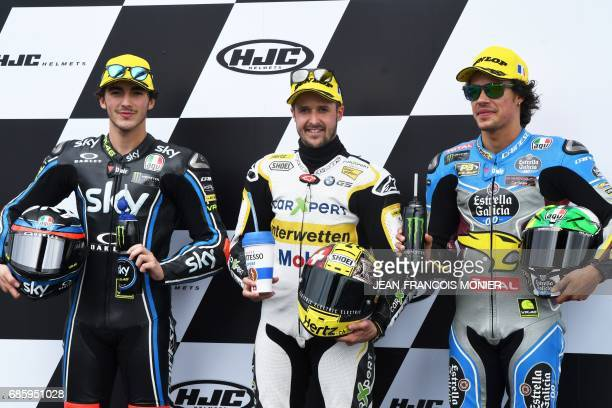 Winner of the Pole Position Switzerland's Thomas Luthi poses next to secondplaced Italy's Francesco Bagnaia and thirdplaced Italy's Franco Morbidelli...