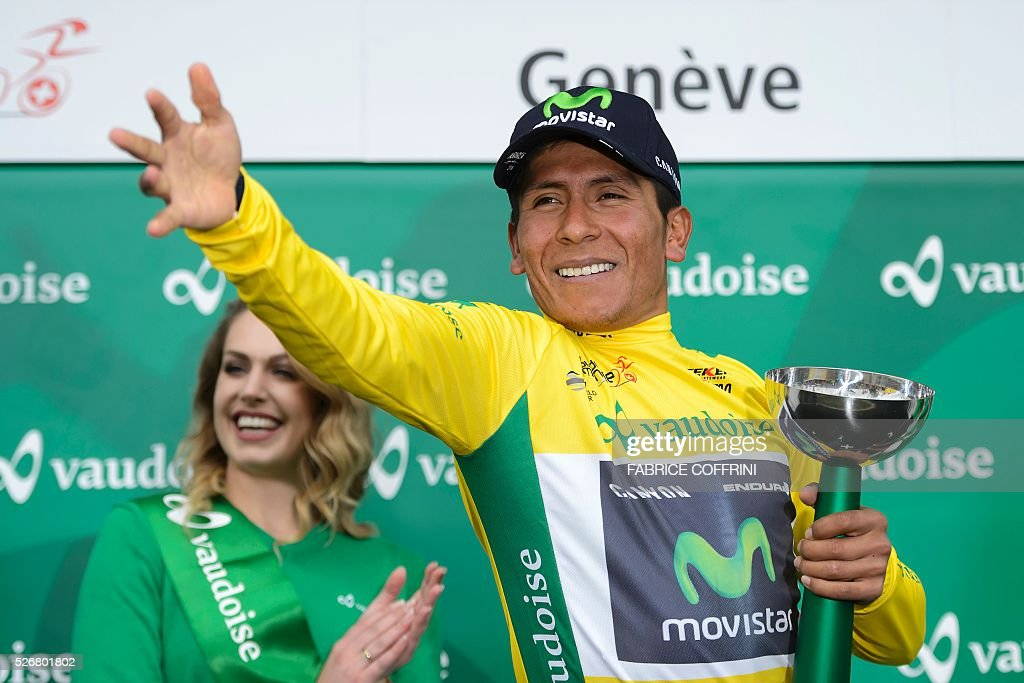 Winner of the race, Colombian Nairo Quintana of Team Movistar gestures during the podium ceremony of the last stage of the 70th Tour de Romandie UCI World Tour, a 177,4 km race from Ollon to Geneva, on May 1, 2016 in Geneva. / AFP / FABRICE