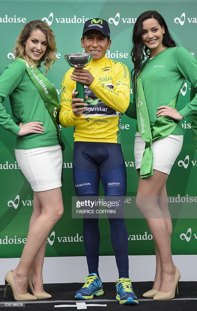 Winner of the race, Colombian Nairo Quintana smiles during the podium ceremony of the last stage of the 70th Tour de Romandie UCI World Tour, a 177,4 km race from Ollon to Geneva, on May 1, 2016 in Geneva. / AFP / FABRICE