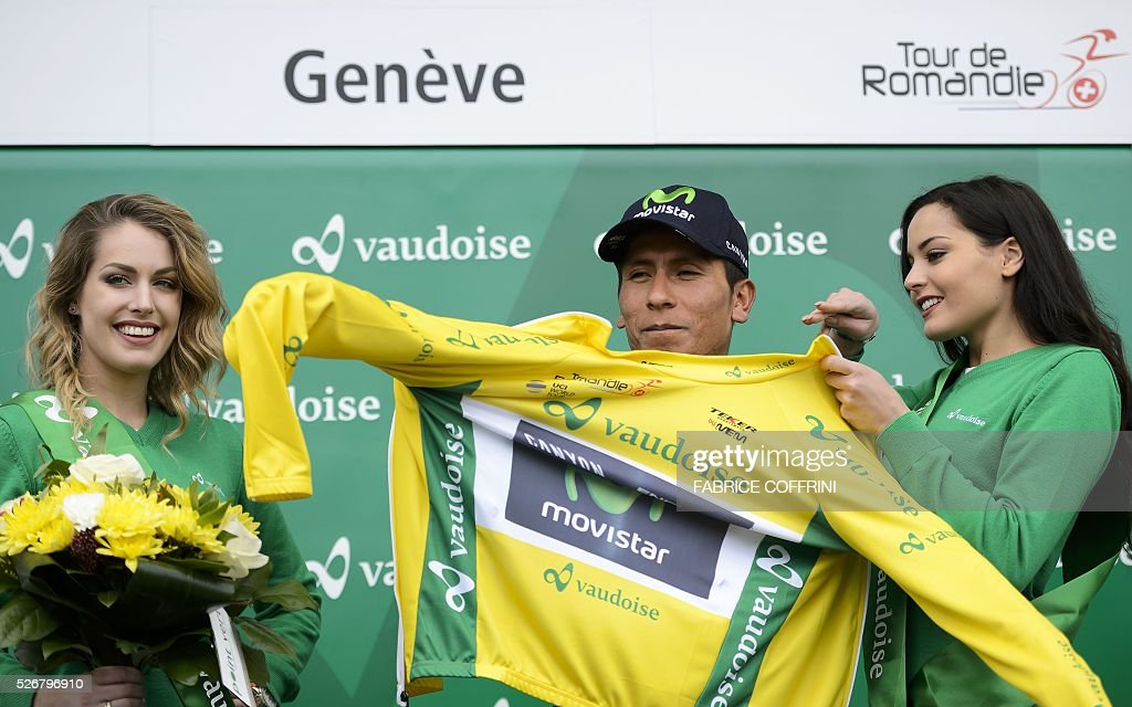 Winner of the race, Colombian Nairo Quintana wears the yellow jersey during the podium ceremony of the last stage of the 70th Tour de Romandie UCI World Tour, a 177,4 km race from Ollon to Geneva, on May 1, 2016 in Geneva. / AFP / FABRICE