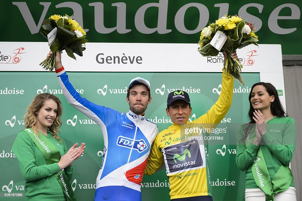 Winner of the race, Colombian Nairo Quintana (R) with his yellow jersey pose next to second of the race French Thibaut Pinot during the podium ceremony of the last stage of the 70th Tour de Romandie UCI World Tour, a 177,4 km race from Ollon to Geneva, on May 1, 2016 in Geneva. / AFP / FABRICE