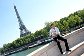 Winner of the Roland Garros 2015 French Tennis Open Stanislas Wawrinka poses with the 'Coupe des Mousquetaires' in front of The Eiffel Tower on June...