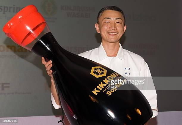 Winner of the 'Seven Sushi Samurai' Sushi of the Year awards 2009 Tomoyuki Abe from Japan poses with an inflateable soy sauce bottle at the Olympia...