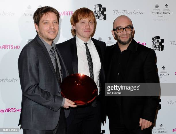 Winner of the South Bank Sky Arts Awards Film for 'Monsters' director Gareth Edwards poses with actor Rupert Grint in the press room at the South...