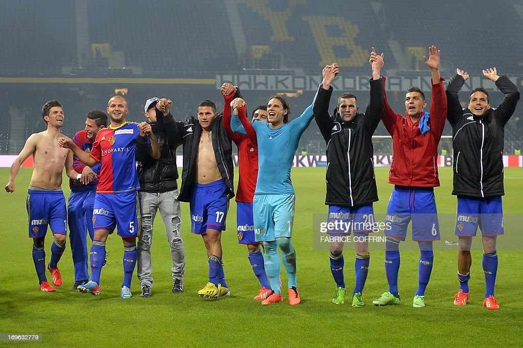 Winner of the Swiss football championships FC Basel's players celebrate their victory 1-0 after their penultimate season's match against Bern Young Boys on May 29, 2013 in Bern. AFP PHOTO / FABRICE COFFRINI