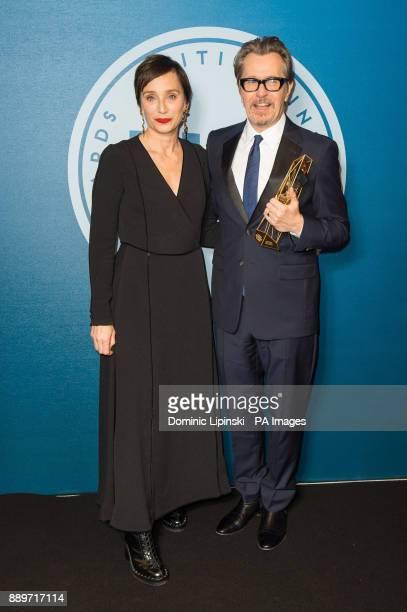 Winner of the Variety Award Gary Oldman with award presenter Kristin Scott Thomas at the British Independent Film Awards at Old Billingsgate in London