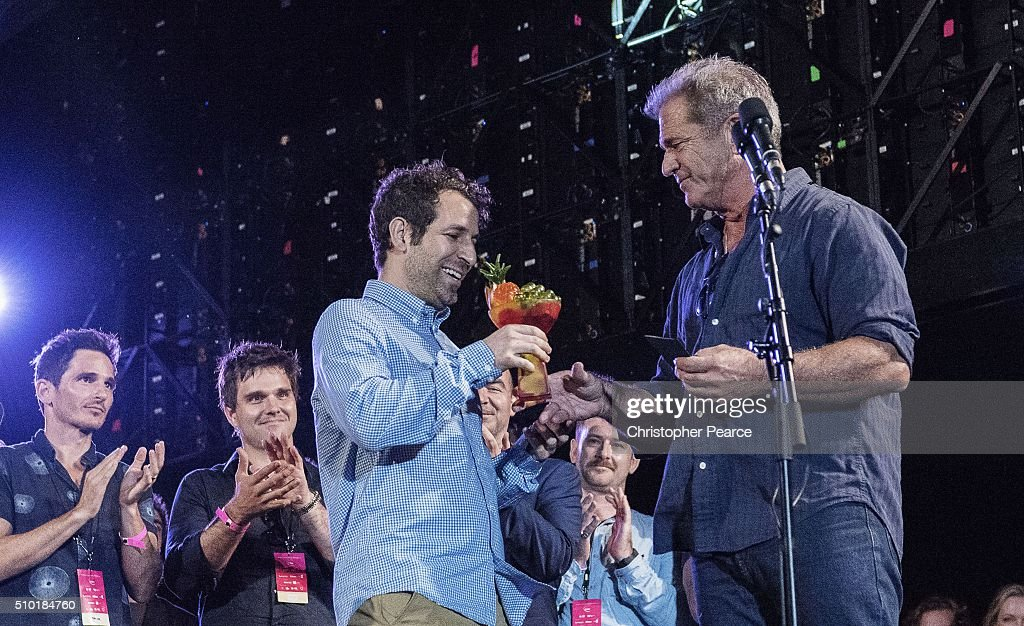 Winner of Tropfest Spencer Susser for his film Shiny is handed his award by judge Mel Gibson at Centennial Park on February 14, 2016 in Sydney, Australia.