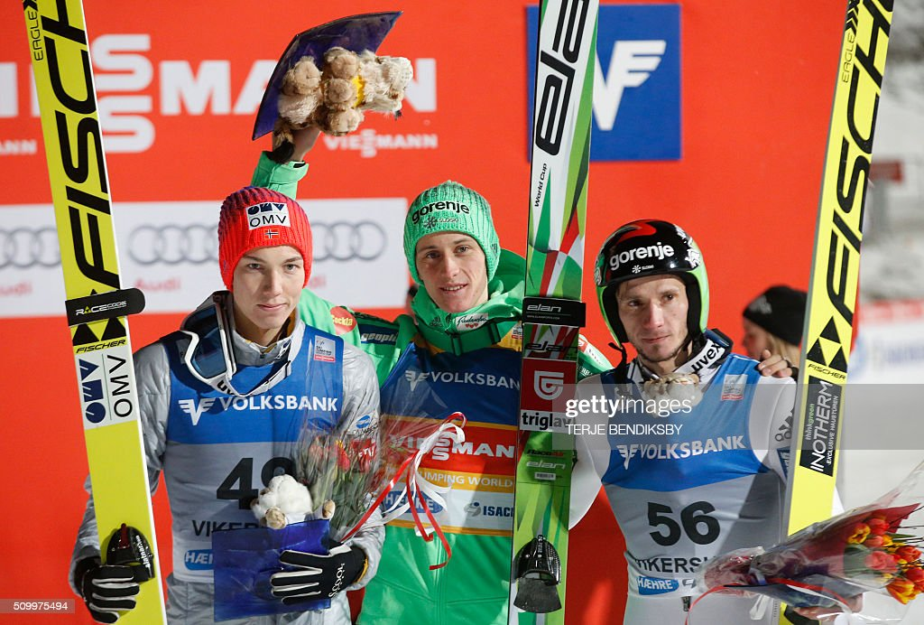 Winner Peter Prevc (C) from Slovenia flanked by second placed Johann Andre Forfang (L) from Norway and third placed Robert Kranjec (R) from Slovenia after the FIS Ski Jumping World Cup Flying Hill competition in Vikersund, on February 13, 2016. / AFP / NTB Scanpix / Terje Bendiksby / Norway OUT