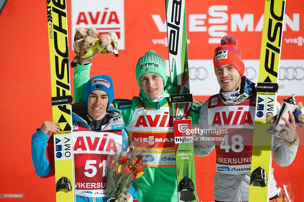 Winner Peter Prevc (C) from Slovenia flanked by second placed Stefan Kraft (L) from Austria and third placed Andreas Stjerne (R) from Norway after the FIS Ski Jumping World Cup Flying Hill competition in Vikersund, on February 14, 2016. / AFP / NTB Scanpix / Terje Bendiksby / Norway OUT
