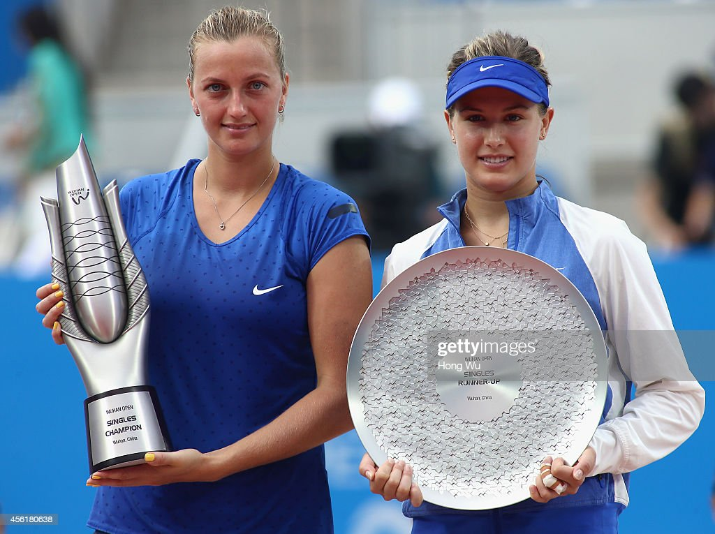 Winner Petra Kvitova of Czech Republic and second place Eugenie Bouchard of Canada hold trophies at the award ceremony after the final match on day...