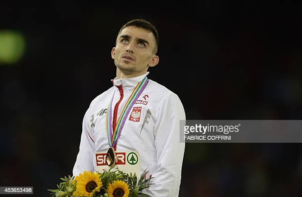 Winner Poland's Adam Kszczot poseS on the podium during the Men's 800m medal cereminy during the European Athletics Championships at the Letzigrund...