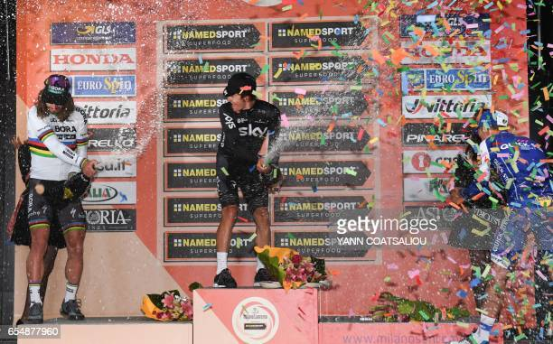 Winner Poland's Michal Kwiatkowski celebrates on the podium with secondplaced Slovakia's Peter Sagan and thirdplaced France's Julian Alaphilippe at...