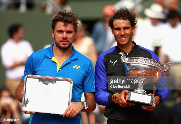 Winner Rafael Nadal of Spain and Runner Up Stan Wawrinka of Switzerland pose with their trophies following the mens singles final on day fifteen of...