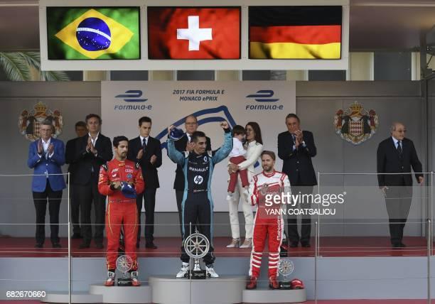 Winner Renault EDams Formula E Team's Swiss driver Sebastien Buemi second placed ABT Schaeffler Audi Sport Formula E team's Brazilian driver Lucas Di...