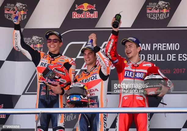 Winner Repsol Honda Team's Spanish rider Dani Pedrosa second placed Repsol Honda Team's Spanish rider Marc Marquez and third placed Movistar Yamaha...