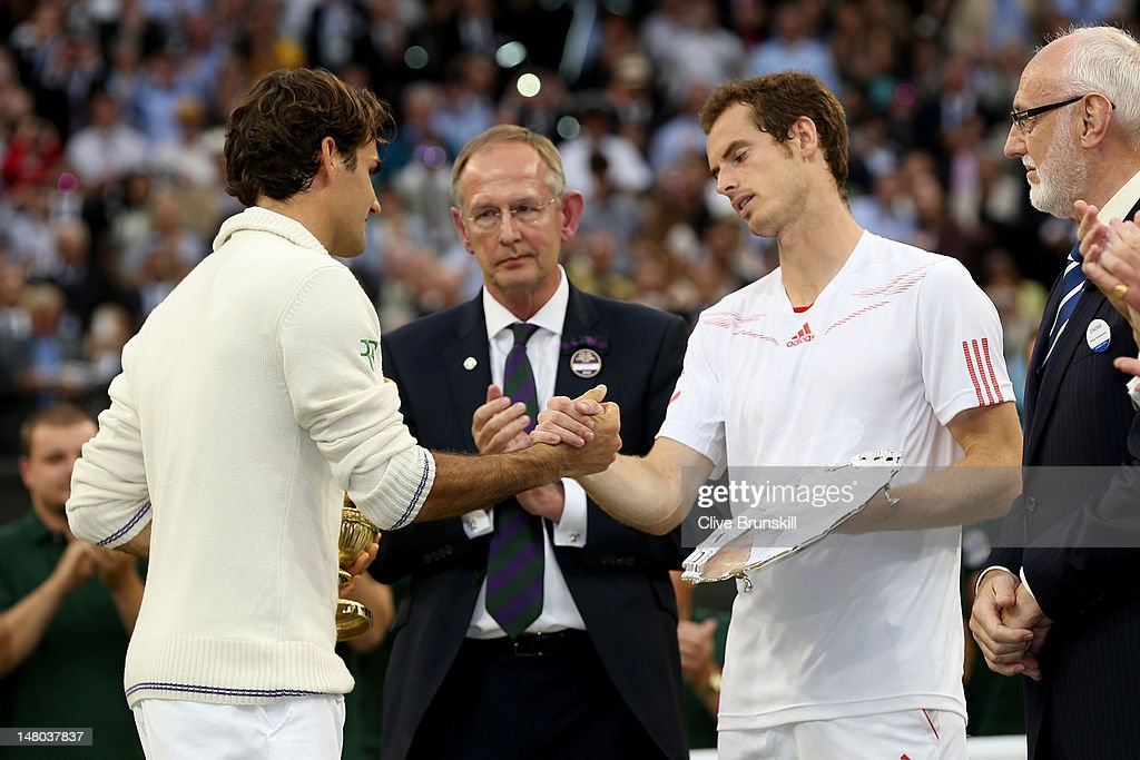 Winner Roger Federer of Switzerland and runner up Andy Murray of Great Britain shake hands after their Gentlemen's Singles final match on day thirteen of the Wimbledon Lawn Tennis Championships at the All England Lawn Tennis and Croquet Club on July 8, 2012 in London, England.