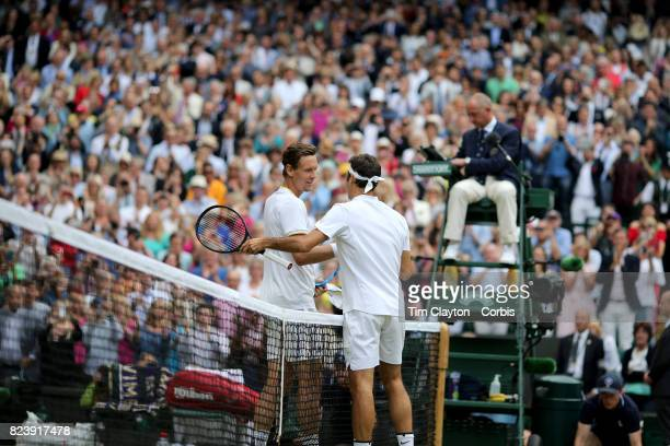 Winner Roger Federer of Switzerland is congratulated by Thomas Berdych of the Czech Republic after the Gentlemen's Singles Semifinal of the Wimbledon...
