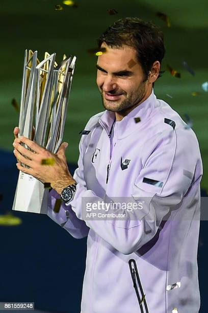 Winner Roger Federer of Switzerland lifts the trophy after the men's singles final match against Rafael Nadal of Spain at the Shanghai Masters tennis...